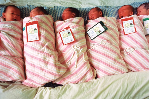 swaddled newborn baby girls