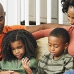 African American Family reading to kids