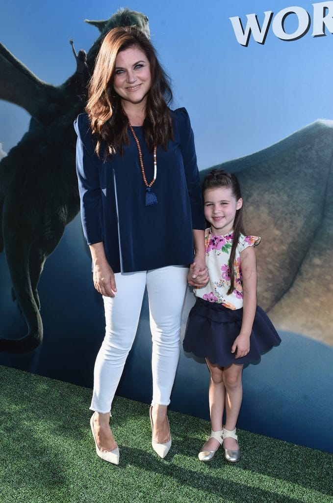 "HOLLYWOOD, CA - AUGUST 08: Actress Tiffani Thiessen (L) and Harper Renn Smith arrive at the world premiere of Disney's ""PETE'S DRAGON"" at the El Capitan Theater in Hollywood on August 8, 2016. The new film, which stars Bryce Dallas Howard, Robert Redford, Oakes Fegley, Oona Laurence, Wes Bentley and Karl Urban and is written and directed by David Lowery, has been drawing rave reviews from both audiences and critics. PETE'S DRAGON opens nationwide August 12, 2016. (Photo by Alberto E. Rodriguez/Getty Images for Disney ) *** Local Caption *** Tiffani Thiessen; Harper Renn Smith"