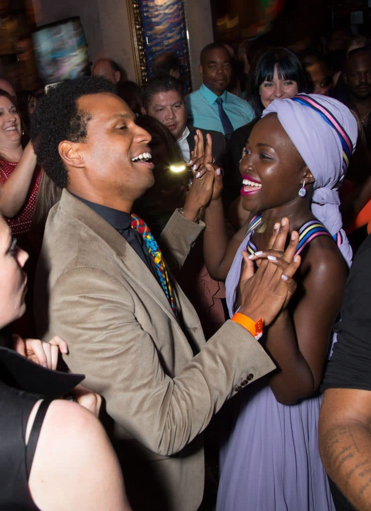 Robert Katende and Lupita Nyong'o dance together