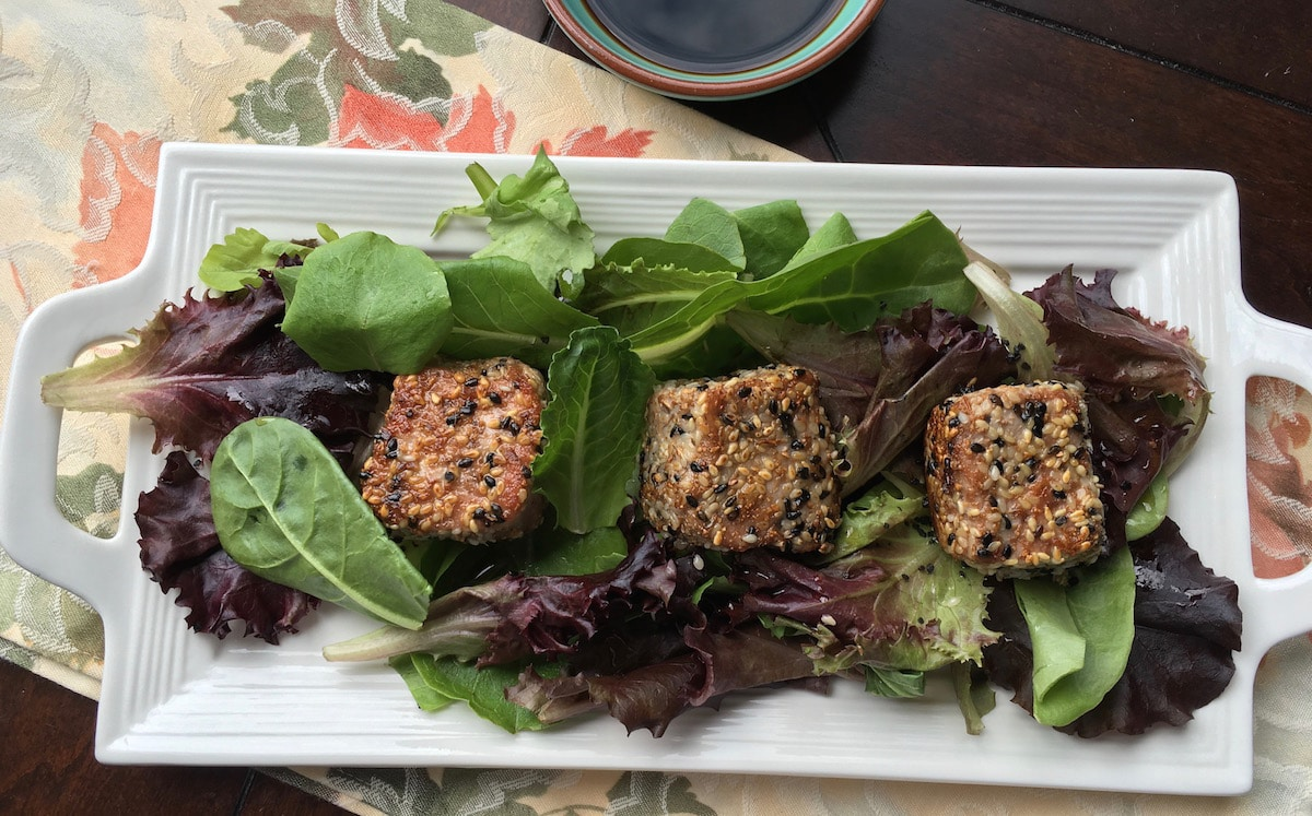 Seared Sesame Tuna with Mixed Greens is a hearty salad with affordable ingredients. This is best served as a light meal of the day. Try this now!
