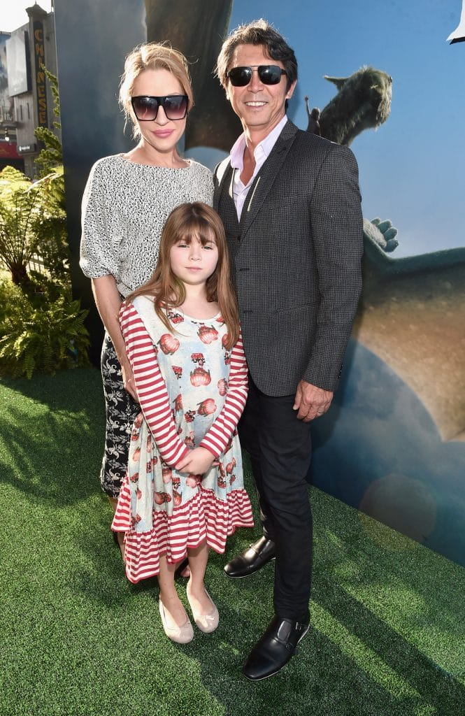 "HOLLYWOOD, CA - AUGUST 08: Actor Lou Diamond Phillips (R) with Yvonne Boismier Phillips and Indigo Sanara Phillips arrive at the world premiere of Disney's ""PETE'S DRAGON"" at the El Capitan Theater in Hollywood on August 8, 2016. The new film, which stars Bryce Dallas Howard, Robert Redford, Oakes Fegley, Oona Laurence, Wes Bentley and Karl Urban and is written and directed by David Lowery, has been drawing rave reviews from both audiences and critics. PETE'S DRAGON opens nationwide August 12, 2016. (Photo by Alberto E. Rodriguez/Getty Images for Disney ) *** Local Caption *** Lou Diamond Phillips; Yvonne Boismier Phillips; Indigo Sanara Phillips"