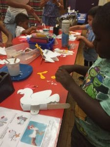 kids make their own puppets at the puppet workshop at the center for puppetry arts