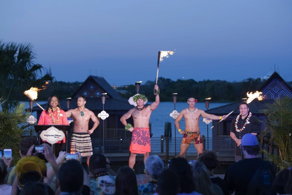 Against the backdrop of sunset on Seven Sea Lagoon March 31, 2015, Walt Disney World Resort and Disney Vacation Club grand-opened the newest resort in the DVC family – Disney's Polynesian Villas & Bungalows. The dedication ceremony featured a Samoan fire-knife dancer, Polynesian drummers and torch-bearers representing the three points of the Polynesian Triangle. The three torches lit a fourth torch in officially opening the newest lodging, part of an overall re-imagination of Disney's Polynesian Village Resort. Pictured: Tracey Powell, vice president of Resort Operations – Deluxe Resorts, and Ken Potrock, senior vice president and general manager of Disney Vacation Club and Adventures by Disney. Walt Disney World Resort is in Lake Buena Vista, Fla. (Mariah Wild, photographer)