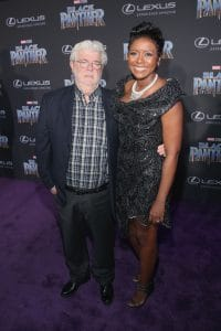 HOLLYWOOD, CA - JANUARY 29: Filmmaker George Lucas (L) and Mellody Hobson at the Los Angeles World Premiere of Marvel Studios' BLACK PANTHER at Dolby Theatre on January 29, 2018 in Hollywood, California. (Photo by Jesse Grant/Getty Images for Disney) *** Local Caption *** George Lucas; Mellody Hobson