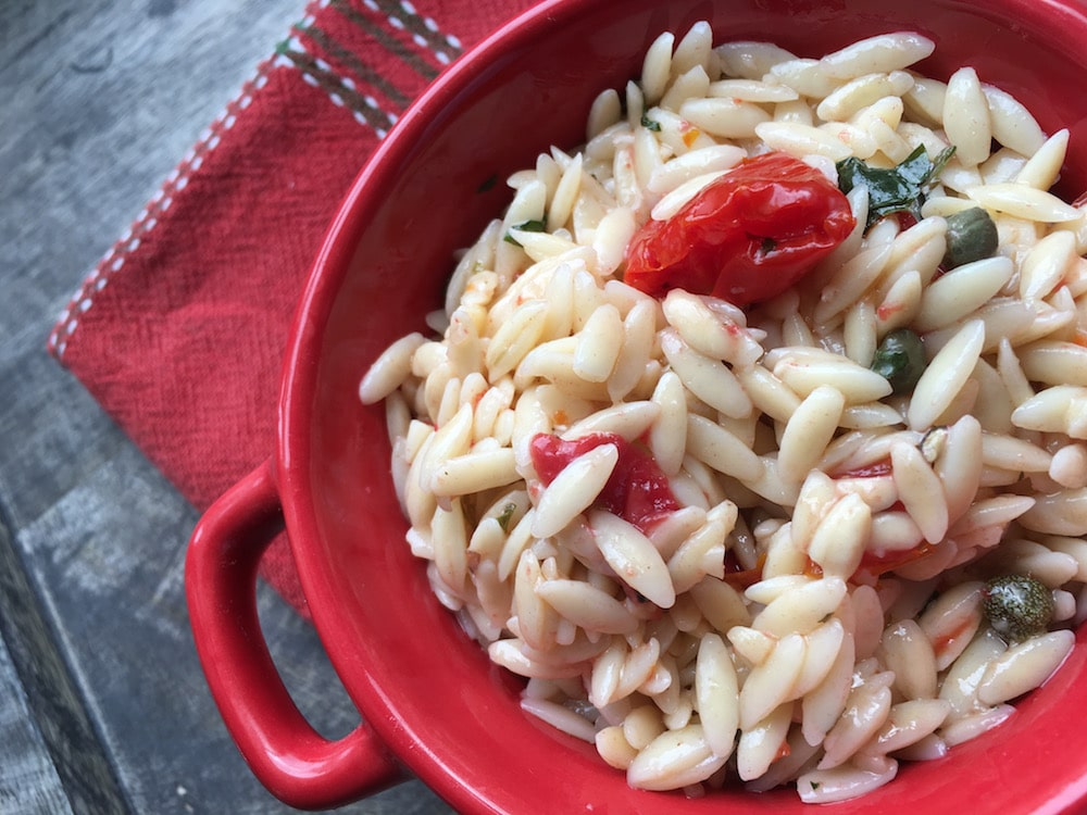 Orzo Pasta Salad with Tomatoes and Capers is a perfect recipe for a hot summer day. This will surely brighten up your day. Check this out!