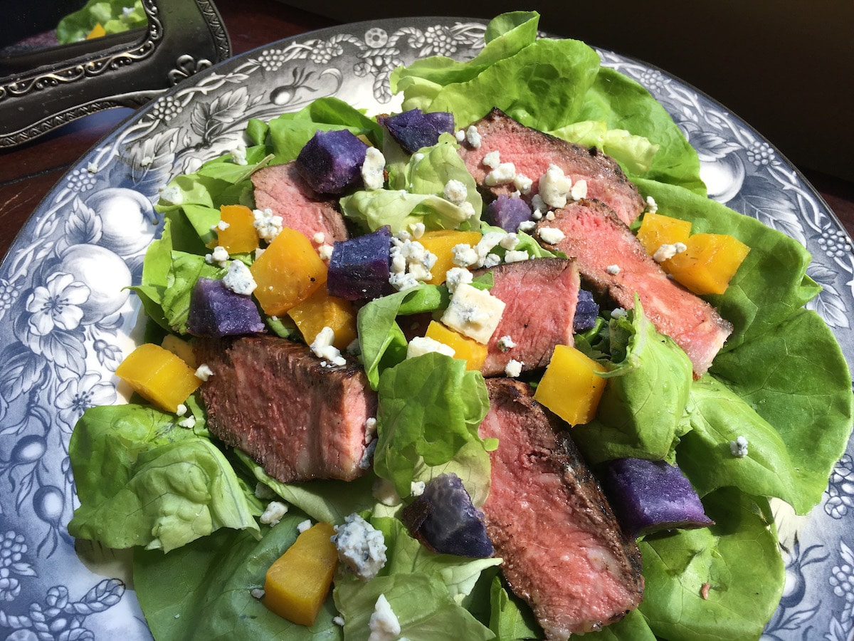Marinated Strip Steak Salad not only tastes heavenly but also looks amazing with its bed of vibrant lime green on top. The homemade blue cheese dressing offers a nice complement to the flavorful steak and roasted root vegetables.