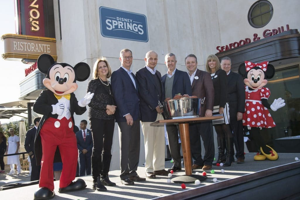 Maria & EnzoÕs at Disney Springs opens to colorful fanfare Thursday, Jan. 4, 2018 following a dedication moment featuring Mickey Mouse and Minnie Mouse and led by (l-r): Maribeth Bisienere, SVP, Disney Springs & ESPN Wide World of Sports Complex; Jerry Jacobs Jr., Co-CEO, Delaware North; Jeremy Jacobs, Chairman, Delaware North; Lou Jacobs, Co-CEO, Delaware North; Keith Bradford, Vice President, Disney Springs; Lisa Onopa, Director, Operating Participants and Nick Valenti, CEO, Patina Restaurant Group. Maria & EnzoÕs is an Italian trattoria set in the townÕs storied abandoned airline terminal from the 1930s now transformed into a restaurant